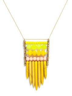 Organic yellow fringe and bright beads come together in this sherbet statement with plenty of festival vibes. #baublebar #swatstyle #necklace