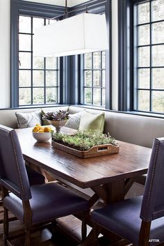 Breakfast Room. Breakfast Room Decorating Ideas. Breakfast room with banquette. The custom L shaped banquette double as window seat. Notice the trestle dining table and blue, square back, dining chairs. #Breakfastroom Alisberg Parker Architects.