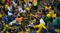 RIO DE JANEIRO, BRAZIL - JUNE 30: (EDITORIAL USE ONLY) In this handout image provided by FIFA Neymar of Brazil is congratulated by fans at the end of the FIFA Confederations Cup Brazil 2013 Final match between Brazil and Spain at Maracana on June 30, 2013 in Rio de Janeiro, Brazil. (Photo by Handout/Alexandre Loureiro/FIFA via Getty Images)
