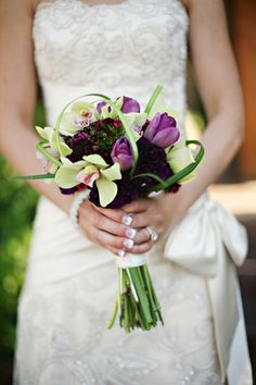 purple green bridal bouquet lily grass cymbidium orchids purple tulips utah