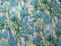 This a vintage Waverly fabric from the 1970s. The style is called Mauna Loa with a beige background, blue flowers and bamboo and a linen texture. It