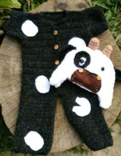 Conjunto confeccionado em crochê em fio antialérgico  Composição macacão, gorro, sapatinhos  Cor - branco e preto  Tamanho 1 ano