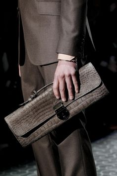 Gucci mens clutch.   Doubt we'll ever see that in Queensland
