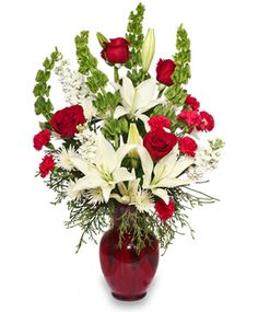 A grand variety of Belles, Roses and other white and red flowers. This Sweet arrangement can go anywhere. A nice addition to a work space with a lovely fragrance to boot.