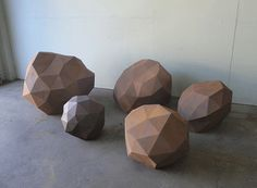 Boulders ...These blew me away. Faceted boulders! Low-res rocks! Talk about a great addition to a landscape, or as a sort of objet d′art (air quotes) in an empty corner of a room. There's not a lot of info, but really, what do you need to know other than they're made from steel?
