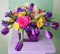 Purple Tulips, Green Cymbidium Orchids, Purple Monte Casino, Yellow Spray Roses, with Magenta Beaded Wires.