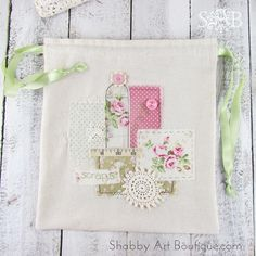 Yesterday I shared with you a few sneak peeks from my craft room. Did you guess what it was? Here's the finished result…. I made my collage into a 'scraps' bag.   Up until now, I had all my loose scraps in a bulging plastic shopping bag. I keep even the tiniest of scraps …