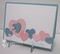 A cute baby card by LeeAnn! It features Hearts a Flutter & its framelits, Sweet Essentials, Perfect Polka Dots embossing folder, & Fashionable Hearts embosslit.