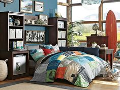 I love the PBteen Stuff-Your-Stuff Surf Bedroom on pbteen.com  i like the blue as an accent wall behind his bed.