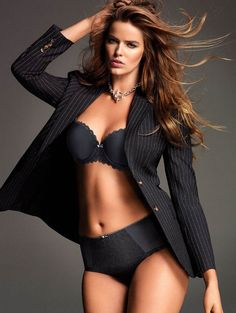 robyn lawley is absolutely amazing, she is considered a plus size model, and people have called her a pig, fat, and hefty. She is so gorgeous and loves her body she is an amazing role model to all