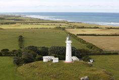 Cape Egmont Lighthouse aerial photo, by Rob Tucker. New Zealand North, Wind Turbine, Lighthouse, Cape, Island, Bell Rock Lighthouse, Light House, Cabo, Cloak