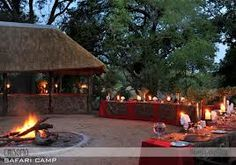 Guests enjoy dinners at the luxuriously furnished, thatched public area overlooking the river and the bush or a traditional braai at a specially created bush dinner site where traditional dishes are served under the stars.