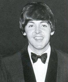 Paul McCartney? Something strange going on here. His jaw looks crooked and both eyes droop at the outer corners .