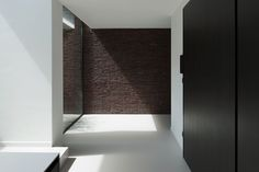 Corridor with daylight. The VHVH House by Belgian architects Claessens Architecten. Photo by Koen van Damme.
