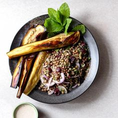 This Middle Eastern inspired eggplant and lentil salad is packed with protein and iron, and given a boost with a creamy tahini dressing.
