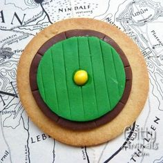 Bilbo Baggins Hobbit House Cookies based on his front Bag End door. This is a typical round door for these Tolkien creatures and it has the brass color door knob in the middle too. Great as a birthday or party themed snack.  Get Baking: http://wizzley.com/hobbit-cookies