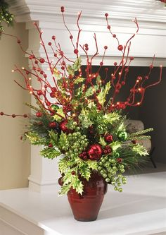 Christmas Vase - I have a HUGE vase and want to use it in my decor somehow. kinda like this! Christmas Flower Arrangements, Christmas Planters, Christmas Flowers, Christmas Table Decorations, Outdoor Christmas, Christmas Projects, Christmas Home, Floral Arrangements, Christmas Wreaths