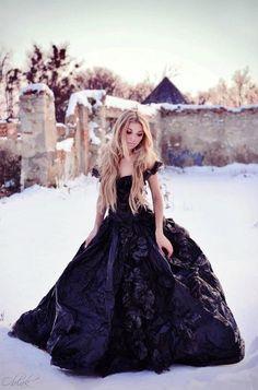 Beautiful black dress in a white winter scene