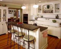 Kitchen : Appealing Small Cottage Kitchen Designs With White Wooden Shelving Cabinet Above Wood Floor And White Wooden Using Dark Brown Wooden Pedestal Countertop Including Dark Brown Metal 3 Chair On The Floor Family Friendly Attributes for Engaging Kitchen Decorations Red Sofa. Rice Bowl. Pink Kitchen Island.
