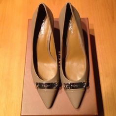 """Coach Bowery pump Coach Bowery pump in stone with silver hardware. Size 7.5. Soft lamb skin leather with patent toe cap. Stacked heel 2 3/4"""" heel. Does have a small nick on the right shoe. Brand new never worn. Coach Shoes Heels"""