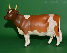"""Antiques Atlas - Beswick Ayrshire Cow CH. """"ICKHAM BESSIE"""" Model No. 1350          5"""" H Designer Arthur Gredington Colour Brown and White, Matte asking price $304.47 plus shipping from UK"""