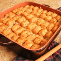 in a 8x8 Pyrex layer: 1lb raw hamburger meat, chopped onion, 1 can cream of chicken soup, shredded Colby Jack cheese, and tater tots.  Use the cooking directions on the tater tot bag (usually a bit longer) use the clear Pyrex so that you can peek at the bottom just to be sure the meat is cooked!  ENJOY