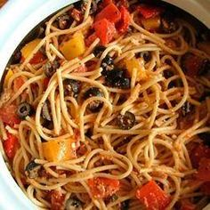 Spaghetti, bacon, celery, onion, bell pepper, olives and tomatoes tossed with salad seasoning, italian dressing and parmesan and served cold.