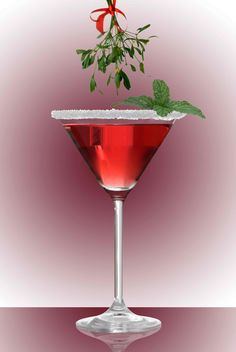 Christmas Mistletoe Cocktail: 2 oz. Finlandia Mango,1 oz. Pomegranate juice, splash of triple sec, Shaken pour into cocktail glass, with white or green sugar rim & garnish with a mint sprig. Cheers.