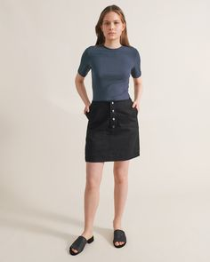 The Button Down Skirt is a straight cut, slim fitting skirt in a cotton twill. Length hits at mid thigh and has a natural waistline with a front entrance button closure. Features front seamed pockets and double top stitch detailing along seams. By Ade Velkon womens brand #fashiondiscovery #AdeVelkon #Skirt #fashion #style #skirts_outfits #fall_skirts #striped_skirts #asymmetrical_skirts #skirts_fashion #designer_skirts #skirt_styles #assymetrical_skirt #winter_skirt #flowy_skirt…