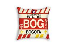 This travel-inspired throw pillow evokes a baggage tag with Bogota El Dorado's…