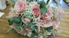 A brides hand tied of sweet avalanche roses gyp and astilbe
