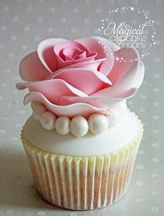 a truly beautiful cupcake! Reminds me of a photo by Ansel Adams of a Rose sitting on an old wood floor. It made me cry.