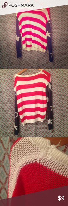 The Classic American Flag Sweater Preowned Super Comfortable American Flag sweater slight unraveling on left shoulder please see third pic. The Classic Sweaters