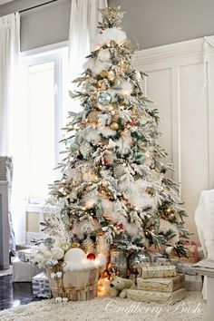 I love this snowy, flocked Christmas tree from My Sweet Savannah