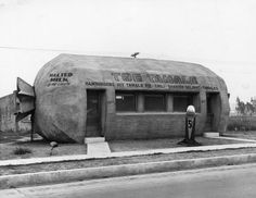 Lunch room specializing in hispanic foods in the shape of a tamale. Located at 6421 Whittier Boulevard in East Los Angeles.  Undated, but ice cream cones are 5 cents, so ...