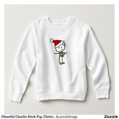 Cheerful Charlie Stick-Fig, Christmas Holiday T-shirt & apparel:  Cheerful Charlie, a cute cartoon stick figure, celebrates the the happy holiday season of Christmas with a festive red scarf, green shirt and red santa hat. --This simple, humorous image appeals to all ages & genders and delivers a 'Merry Christmas feeling'. Original cartoon drawing by Paula Bragg.   -Image appears on variety of products such as cards & posters, t-shirts & apparel, home decor, mugs & kitchen ware, office and…
