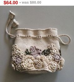 Bag small handmade Irish lace. Crochet, decorated with flowers. Style boho, retro.