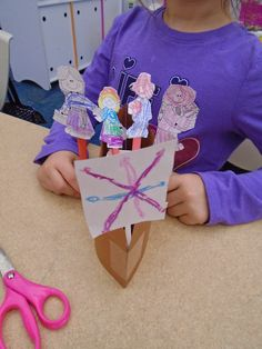 """Milk carton """"Mayflower"""" with popsicle stick puppets."""