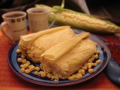 Ecuadorian food, this is yummy! Humitas,corn paste like dough with cheese(queso fresco)(salt and pepper to taste or just salt,some people may add more flavors depending where they are from in Ecuador ), wrapped in corn husk tied and then steamed for few minutes done!  unwrap and eat :) I had these in Quito, Ecuador....soooo good! =)