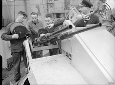 20 mm Oerlikon gunners of HMS Starling(a Modified Black Swan class Sloop) on arrival at Liverpool. Left to right: Able Seaman Edward O'Malley, Able Seaman John Smith, Able Seaman Edward Webster, and Petty Officer William G Barnshaw, of Naval History, Ww2 Aircraft, Navy Ships, Korean War, American Soldiers, Royal Navy, Battleship, Belfast, World War Two