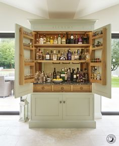 As a gin connoisseur homeowner Stuart indulged his passion with this bespoke drinks cabinet affectionately titled his 'alchemy cupboard' hence the bespoke engraving above the doors. Home Bar Cabinet, Drinks Cabinet, Pantry Design, Kitchen Design, Bar Sala, Kitchen Icon, Inframe Kitchen, Family Kitchen, Larder Cupboard