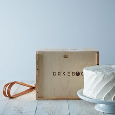 the reusable pine box that will hold one 9 layer cake or 18 cupcakes