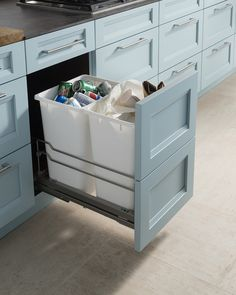 The most popular interior storage feature requested during kitchen updates is a pull-out waste/recycling cabinet. #Houzz #DesignTrend #WoodMode