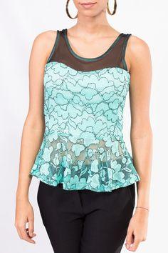 Este elegante blusa en color verde menta y sin mangas también está disponible en color coral en tallas S, M y L