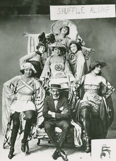 original 1921 Shuffle Along cast. Noble Sissle is front, Adelaide Hall is directly behind him in the center.