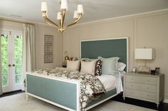 LOVE THIS BED- the colors, the frame, the bedding
