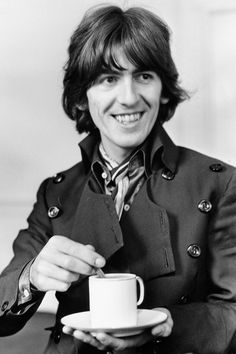 """George Harrison, 1968, photographed by Bill Zygmant  """"I was surprised, actually, to discover that George was so attractive in person. I'd always thought of Paul as the cute one, but up close George was ruggedly handsome, even striking, with his long hair curling up just above the shoulders, his face smooth and clear, and those dark, intense eyes. But it was definitely his smile that hooked me - this incredibly sexy, crooked grin, almost a friendly sneer (like Elvis, I thought) that etched…"""