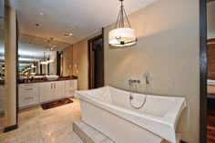 Huge bathtub in this beautiful bathroom!