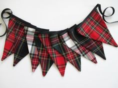 Bunting made from a variety of Stewart tartan fabrics including Royal, New Stewart Black, Modern or Dress and Green. Flags are two layers of fabric sewn together, no raw edges showing, attached to black bias binding. Nine flags for a total length about 72 with about 18 extra on the ends