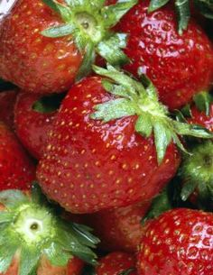 How to Make  Cheesecake-Stuffed Strawberries  We;;. kind of healthy....it's fruit! :)